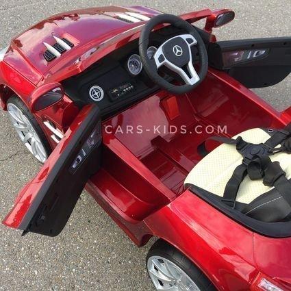 Электромобиль Mercedes-Benz SL63 AMG красный (колеса резина, кресло кожа, пульт, музыка)
